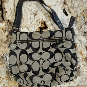 Black and tan multi function Coach purse